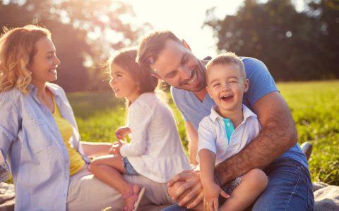 Family in park in sunshine